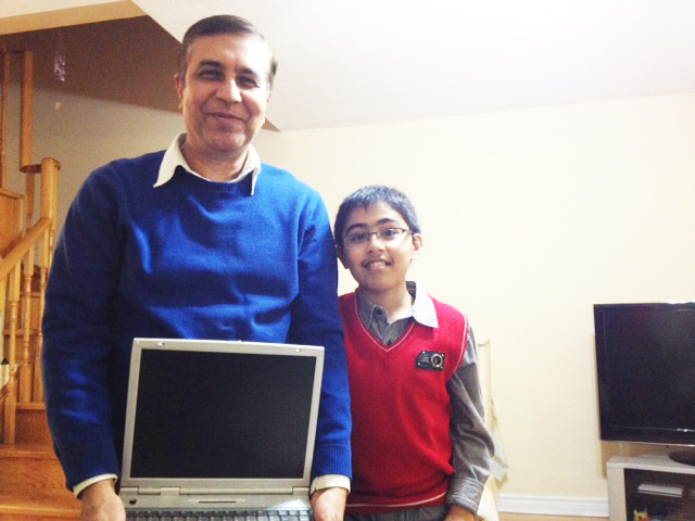 !0-year-old Tanmay seen here with his dad and teacher Puneet Bakshi. Puneet proudly shows of the laptop that Tanmay broke when he was a mere toddler.
