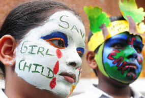A girl gets her painted in Chandigarh, India to create awareness of the disturbing practice of female feticide. (Reuters)