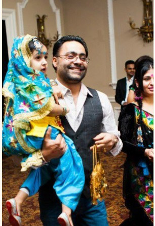 A father brings his daughter to the Lohri for Her, an event in Toronto by Nach Balliye, that celebrates girls. Photo courtesy Nach Balliye