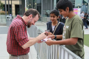 Kitchener, Ont. native Dawud Wharnsby, a Canadian singer/songwriter/poet best known for his work in musical poetic genre interacts with his young fans at the MuslimFest. Photo courtesy, MuslimFest.