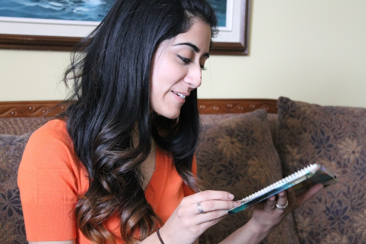 Toronto crooner Jonita Gandhi reads out the contents of a journal she had started when she was seven. Jonita has sung half-a-dozen tracks for Bollywood films, including the title song of Chennai Express, which she sung along with S.P. Balasubramanium, the South Indian icon. (supplied photo).
