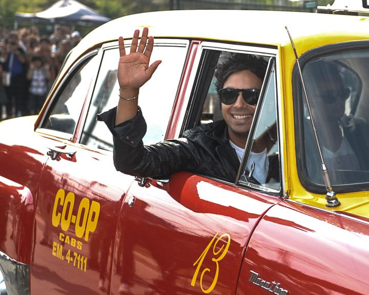 Big Bang Theory actor Kunal Nayyar arrives in a cab at the music launch of his first film, Dr. Cabbie. Photo by Claudio Cugiliari.