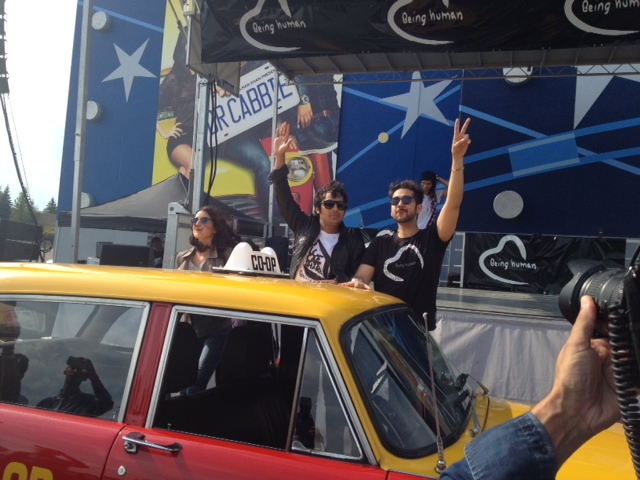 From L to R: Isabelle Kaif, Kunal Nayyar and Vinay Virmani, as they arrive for the music launch of Dr. Cabbie in a yellow and red cab. Photo by Radhika Panjwani