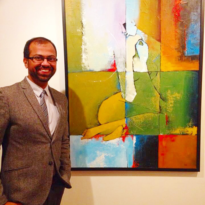 Vishal Misra, an accomplished artist/illustrator seen here with his work. The Toronto accountant has successfully made a name for himself here in North America with his works. Supplied photo.
