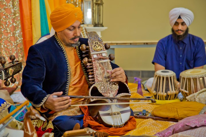 Prof. Surinder Singh seen here playing the saranda. The ancient musical instrument which had faded into obscurity has been revived by Surinder Singh. Photo courtesy, Harbirz Inc.
