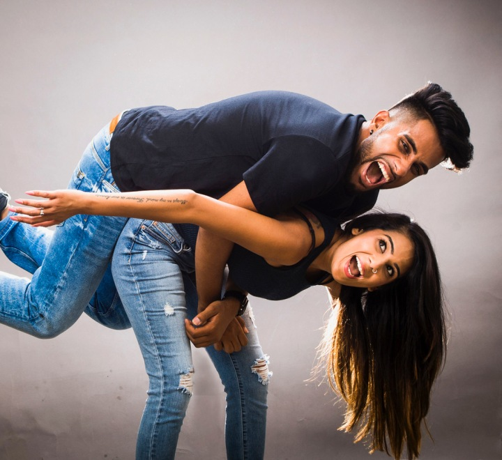 YouTwoTV's Jaz and Harjit pose in a goofy shot.