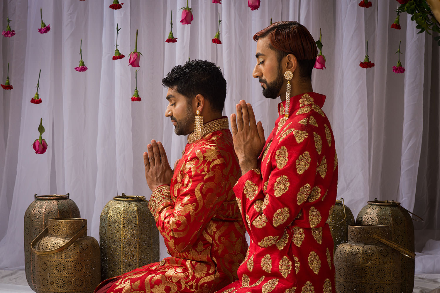 two men seen reflecting with their eyes closed and hands folded in a namaste
