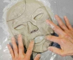 a photo of hands moulding clay