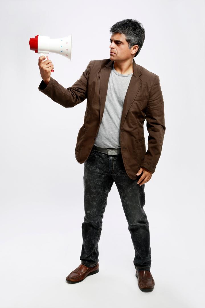 Atul Khatri holding a bullhorn