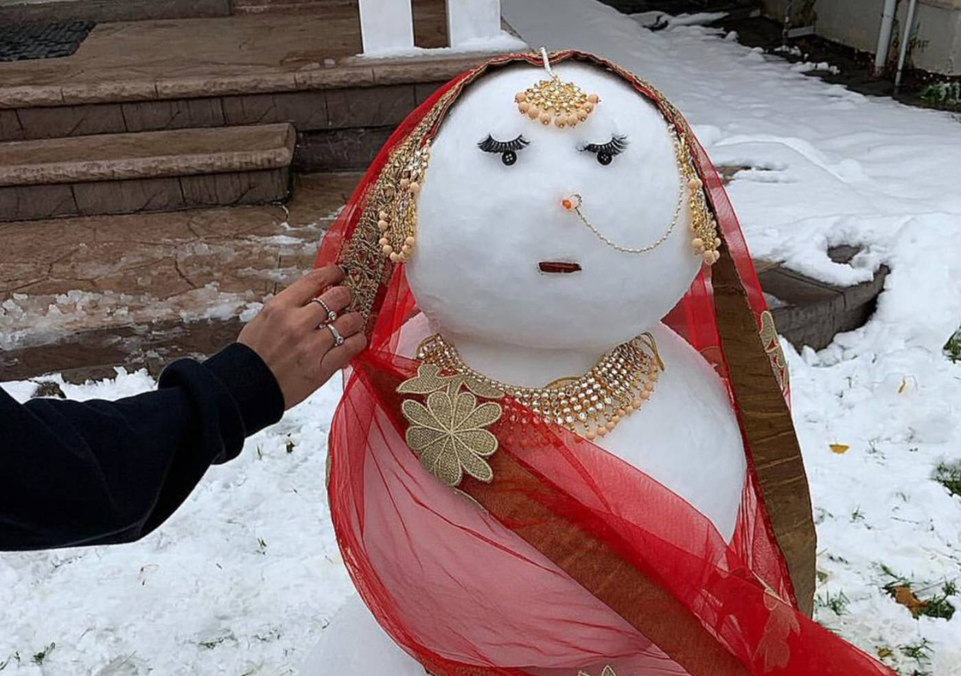 A snow-woman created to look like a South-Asian bride