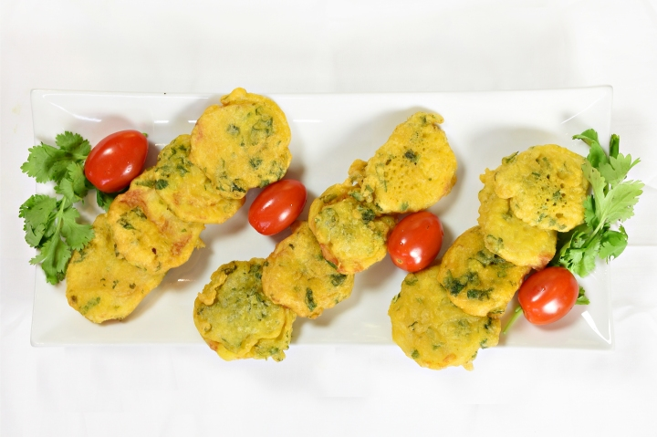 A photo of skewer of kababs.