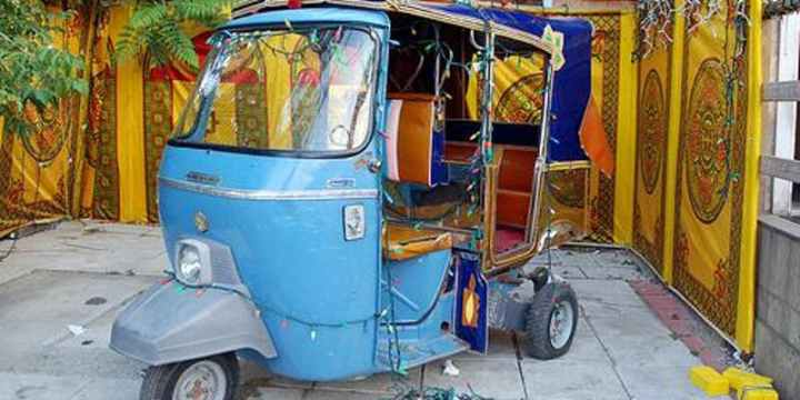 A photo of a blue autorickshaw