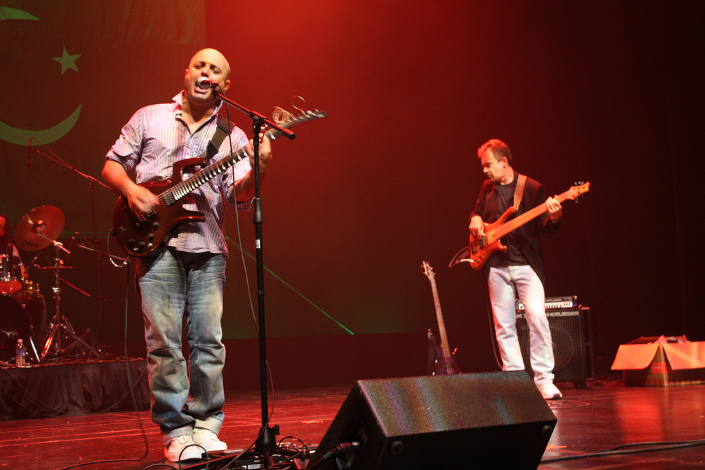 Image shows an artist with guitar singing. The singer is a member of Junoon, a sufi-rock band.